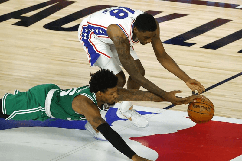 Aug 19, 2020; Lake Buena Vista, Florida, USA; Marcus Smart #36 of the Boston Celtics knocks the ball loose from Shake Milton #18 of the Philadelphia 76ers during the second quarter in game two of the first round of the 2020 NBA Playoffs at The Field House.