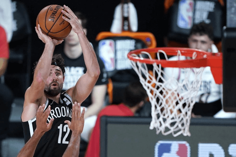 Aug 13, 2020; Lake Buena Vista, Florida, USA; Brooklyn Nets' Joe Harris shoots against the Portland Trail Blazers during the second half of an NBA basketball game at ESPN Wide World of Sports Complex.