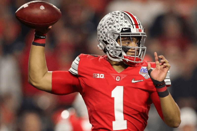 GLENDALE, ARIZONA - DECEMBER 28: Quarterback Justin Fields #1 of the Ohio State Buckeyes throws a pass during the PlayStation Fiesta Bowl against the Clemson Tigers at State Farm Stadium on December 28, 2019 in Glendale, Arizona. The Tigers defeated the Buckeyes 29-23.
