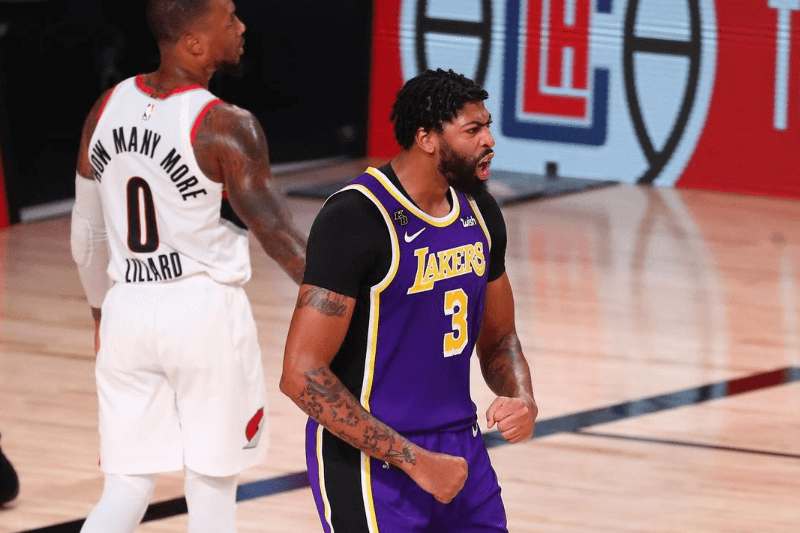 Aug 22, 2020; Lake Buena Vista, Florida, USA; Los Angeles Lakers forward Anthony Davis (3) reacts after dunking against the Portland Trail Blazers in the second half in game three of the first round of the 2020 NBA Playoffs at AdventHealth Arena