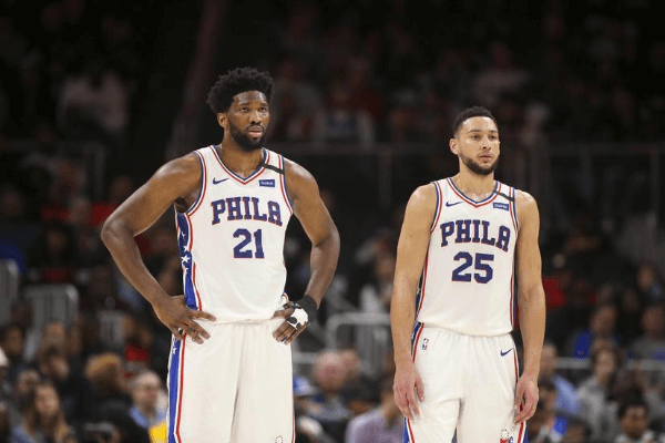 Jan 30, 2020; Atlanta, Georgia, USA; Philadelphia 76ers center Joel Embiid (21) and guard Ben Simmons (25) during a free throw against the Atlanta Hawks in the second quarter at State Farm Arena