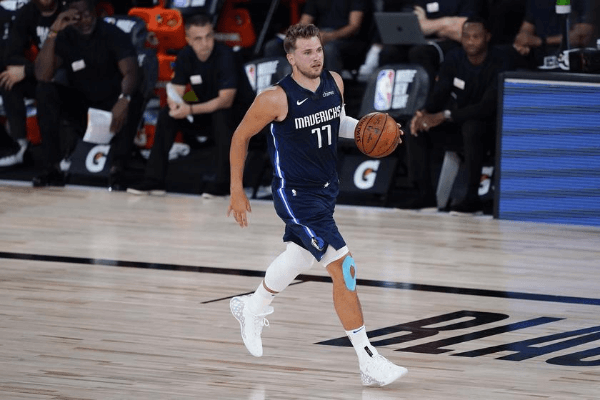 Aug 2, 2020; Lake Buena Vista, USA; Dallas Mavericks guard Luka Doncic (77) brings the ball up court against the Phoenix Suns during the first half of an NBA basketball game Sunday, Aug. 2, 2020, in Lake Buena Vista, Fla.