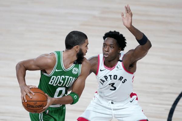 Aug 7, 2020; Lake Buena Vista, Florida, USA; Boston Celtics' Jayson Tatum (0) works against Toronto Raptors' OG Anunoby (3) during the second half of an NBA basketball game at The Arena