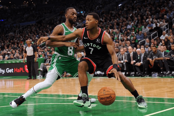 Oct 25, 2019; Boston, MA, USA; Toronto Raptors guard Kyle Lowry (7) controls the ball while Boston Celtics guard Kemba Walker (8) defends during the first half at TD Garden.