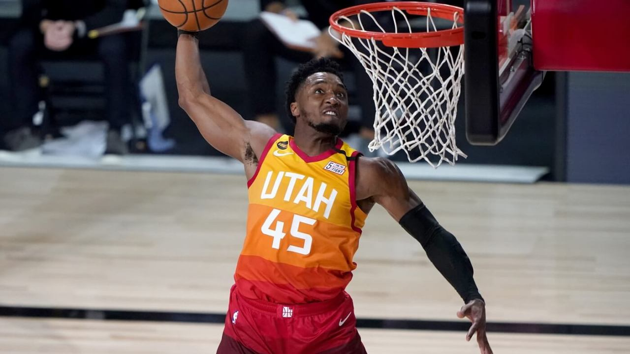 Aug 21, 2020; Lake Buena Vista, Florida, USA; Utah Jazz's Donovan Mitchell (45) dunks against the Denver Nuggets during the second half of an NBA basketball first round playoff game Friday, Aug. 21, 2020, in Lake Buena Vista, Fla. at AdventHealth Arena. Mandatory Credit: Ashley Landis/Pool Photo-USA TODAY Sports