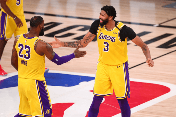 Sep 10, 2020; Lake Buena Vista, Florida, USA; Los Angeles Lakers forward Anthony Davis (3) celebrates with forward LeBron James (23) after making a basket in the second half against the Houston Rockets in game four of the second round of the 2020 NBA Playoffs at AdventHealth Arena. Mandatory Credit: Kim Klement-USA TODAY Sports