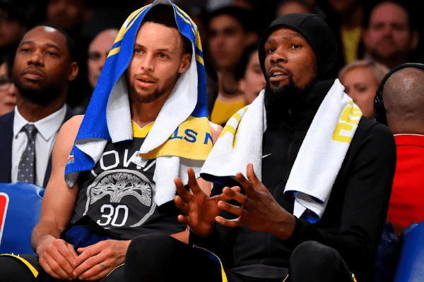 Apr 4, 2019; Los Angeles, CA, USA; Golden State Warriors guard Stephen Curry (30) and forward Kevin Durant (35) sit on the bench in the second half of the game against the Los Angeles Lakers at Staples Center.