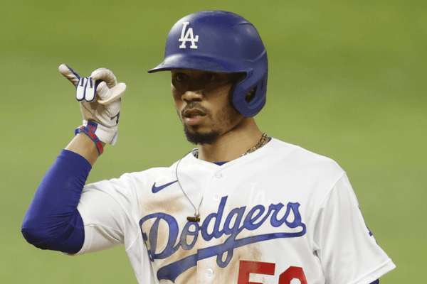 Oct 20, 2020; Arlington, Texas, USA; Los Angeles Dodgers right fielder Mookie Betts (50) celebrates after his single in the 8th inning against the Tampa Bay Rays during game one of the 2020 World Series at Globe Life Field. Mandatory Credit: Tim Heitman-USA TODAY Sports