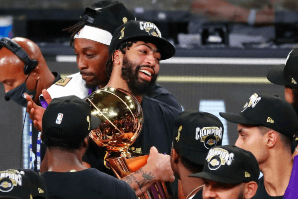Oct 11, 2020; Lake Buena Vista, Florida, USA; Los Angeles Lakers forward Anthony Davis (3) holds the Finals trophy after game six of the 2020 NBA Finals at AdventHealth Arena. The Los Angeles Lakers won 106-93 to win the series.