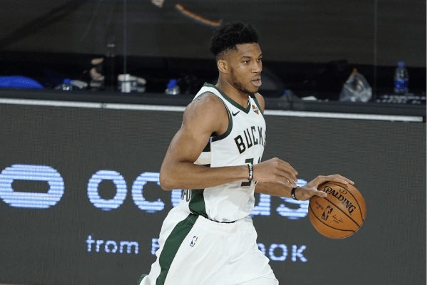 ug 24, 2020; Lake Buena Vista, Florida, USA; Milwaukee Bucks' Giannis Antetokounmpo drives up court against the Orlando Magic during the second half in game four of the first round of the 2020 NBA Playoffs at The Field House.