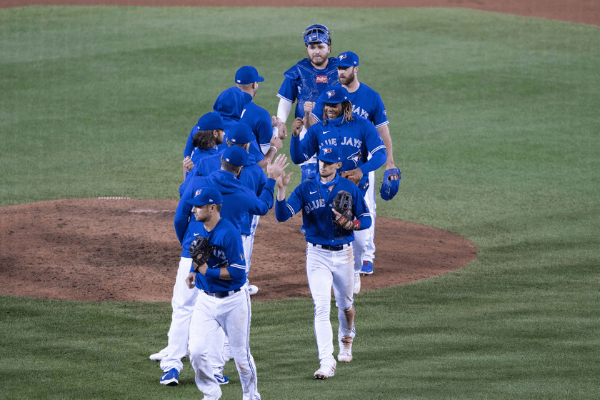 Sep 26, 2020; Buffalo, New York, USA; Toronto Blue Jays third baseman Cavan Biggio (8) and designated hitter Vladimir Guerrero Jr. (27) and pitcher Anthony Bass (52) and designated hitter Alejandro Kirk (85) celebrate with teammates after defeating the Baltimore Orioles at Sahlen Field.