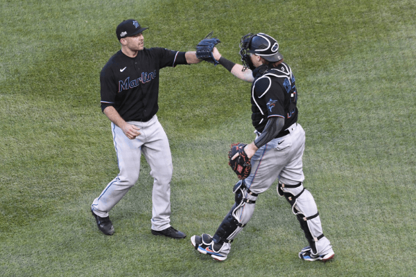 Oct 2, 2020; Chicago, Illinois, USA; Miami Marlins relief pitcher Brandon Kintzler (27) and catcher Chad Wallach (17) celebrate after getting the last out against the Chicago Cubs in game two of a Wild Card playoff baseball game at Wrigley Field.