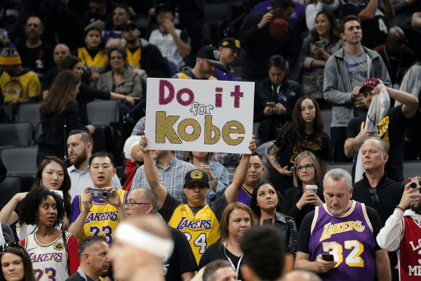 Feb 1, 2020; Sacramento, California, USA; A Los Angeles Lakers fan holds up a Do it for Kobe sign during the first quarter against the Sacramento Kings at Golden 1 Center.