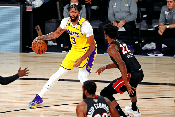 Oct 6, 2020; Miami, Florida, USA; Los Angeles Lakers forward Anthony Davis (3) handles the ball against Miami Heat forward Jimmy Butler (22) during the second quarter in game 4 of the 2020 NBA Finals at AdventHealth Arena.