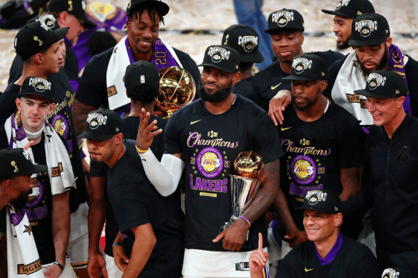Oct 11, 2020; Lake Buena Vista, Florida, USA; Los Angeles Lakers forward LeBron James (23) holds up four fingers after winning his fourth NBA championship after game six of the 2020 NBA Finals at AdventHealth Arena. The Los Angeles Lakers won 106-93 to win the series.