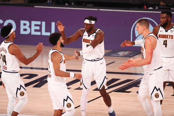 Sep 26, 2020; Lake Buena Vista, Florida, USA; Denver Nuggets players celebrate a play against the Los Angeles Lakers during the third quarter in game five of the Western Conference Finals of the 2020 NBA Playoffs at AdventHealth Arena.