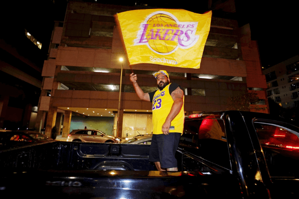 Oct 11, 2020; Los Angeles, CA, USA; Fans celebrate after the Los Angeles Lakers won the 2020 NBA finals against the Miami Heat in the streets around Staples Center.