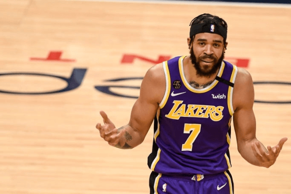 JaVale McGee (7) of the Los Angeles Lakers is called for fouling Jamal Murray (27) of the Denver Nuggets during the first quarter on Wednesday, February 12, 2020.