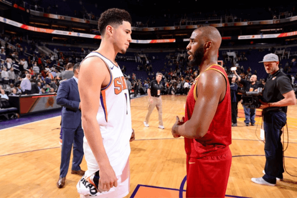 Devin Booker #1 of the Phoenix Suns and Chris Paul #3 of the Houston Rockets talk after the game on February 4. 2019 at Talking Stick Resort Arena in Phoenix, Arizona.