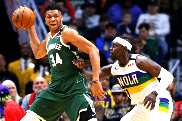 Giannis Antetokounmpo #34 of the Milwaukee Bucks drives against Jrue Holiday #11 of the New Orleans Pelicans during the second half at the Smoothie King Center on February 04, 2020 in New Orleans, Louisiana.