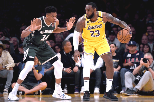 LeBron James #23 of the Los Angeles Lakers backs in on Giannis Antetokounmpo #34 of the Milwaukee Bucks during the third quarter at Staples Center on March 06, 2020 in Los Angeles, California.