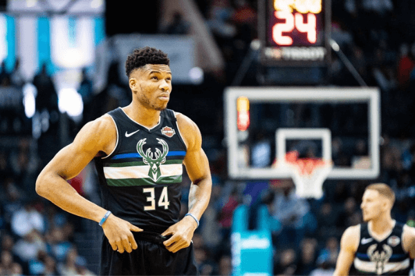 Giannis Antetokounmpo #34 of the Milwaukee Bucks looks on before their game against the Charlotte Hornets at Spectrum Center on March 01, 2020 in Charlotte, North Carolina.