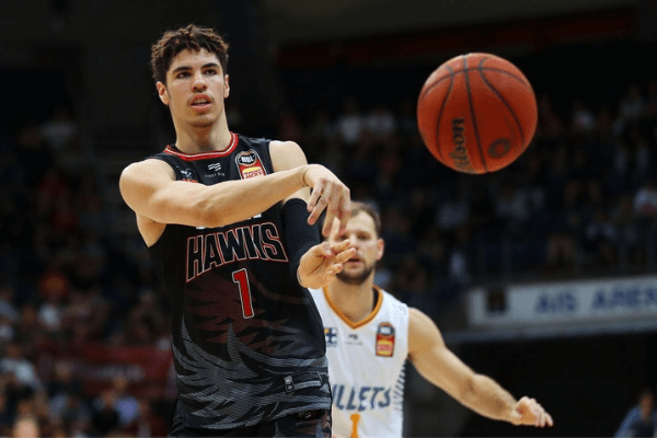 Lamelo Ball of the Hawks passes during the round five NBL match between the Illawarra Hawks and the Brisbane Bullets at AIS Arena on November 03, 2019 in Canberra, Australia.
