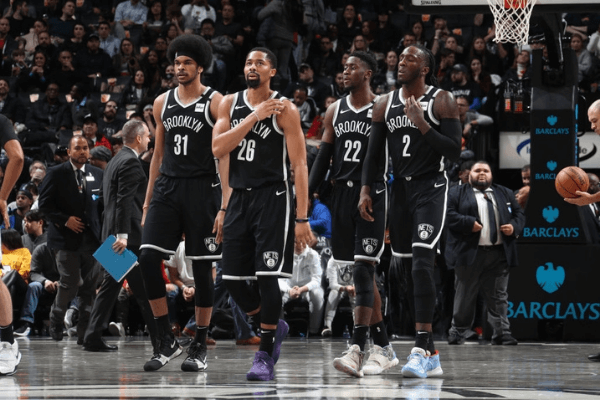 Jarrett Allen #31, Spencer Dinwiddie #26, Caris LeVert #22, and Taurean Prince #2 of the Brooklyn Nets looks on during the game against the Orlando Magic on February 24, 2020 at Barclays Center in Brooklyn, New York.