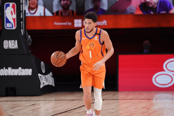Devin Booker #1 of the Phoenix Suns dribbles the ball up court on August 13, 2020 at AdventHealth Arena in Orlando, Florida.