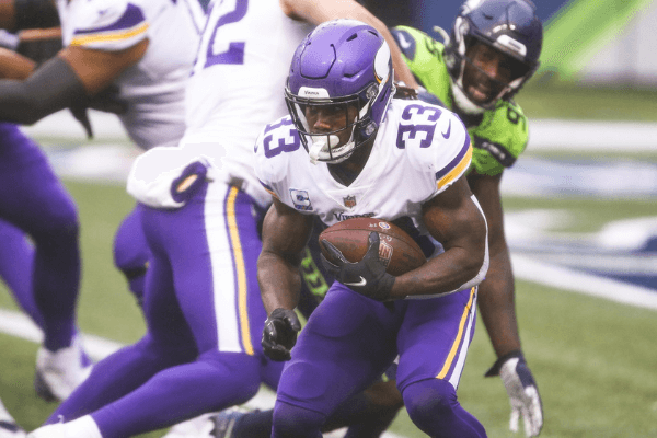 Oct 11, 2020; Seattle, Washington, USA; Minnesota Vikings running back Dalvin Cook (33) rushes against the Seattle Seahawks during the second quarter at CenturyLink Field.