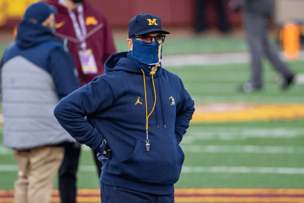 Oct 24, 2020; Minneapolis, Minnesota, USA; Michigan Wolverines head coach Jim Harbaugh looks on during pre game warmups before a game against the Minnesota Golden Gophers at TCF Bank Stadium.