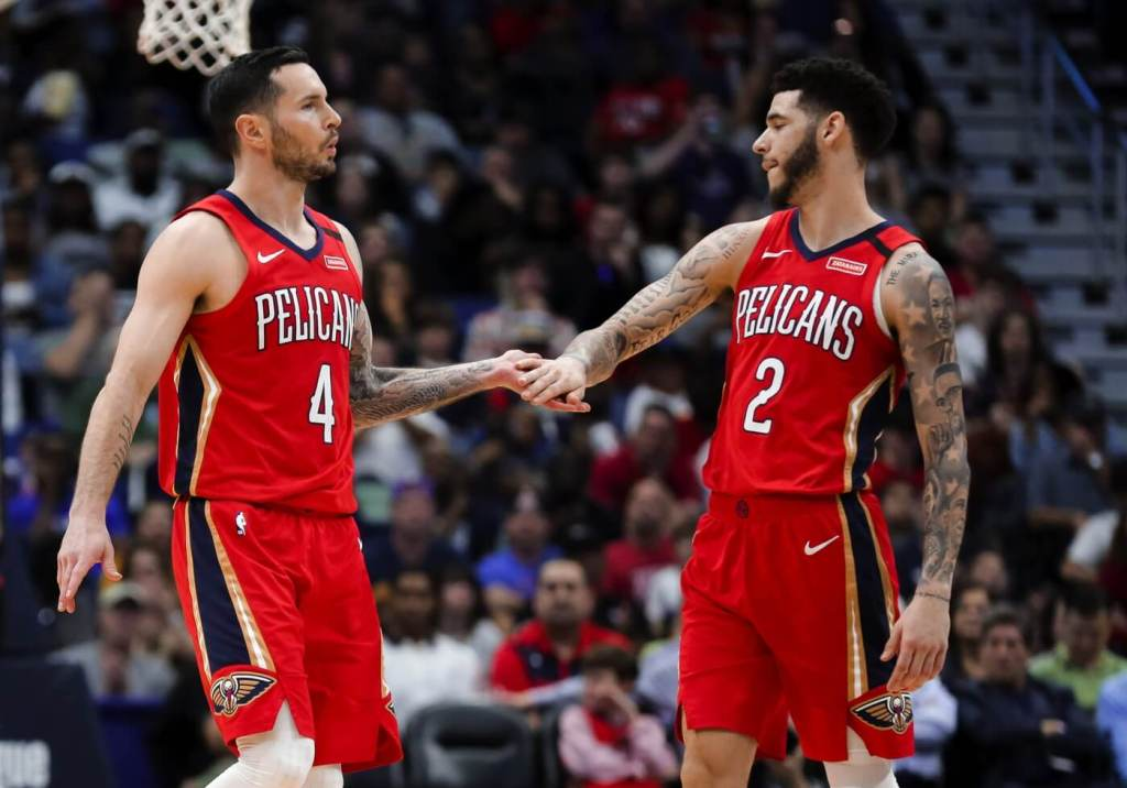 New Orleans Pelicans guard JJ Redick (4) reacts with guard Lonzo Ball (2) after a foul on the Los Angeles Clippers during the first half at the Smoothie King Center.
