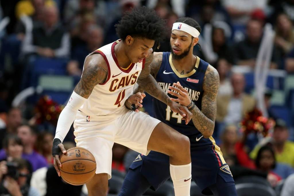 Cleveland Cavaliers guard Kevin Porter Jr. (4) is defended by New Orleans Pelicans forward Brandon Ingram (14) in the second half at the Smoothie King Center.