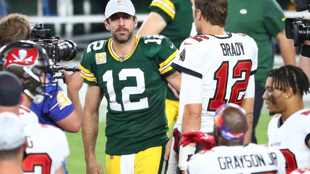 Tampa Bay Buccaneers quarterback Tom Brady (right) greets Green Bay Packers quarterback Aaron Rodgers (left) after a NFL game at Raymond James Stadium.