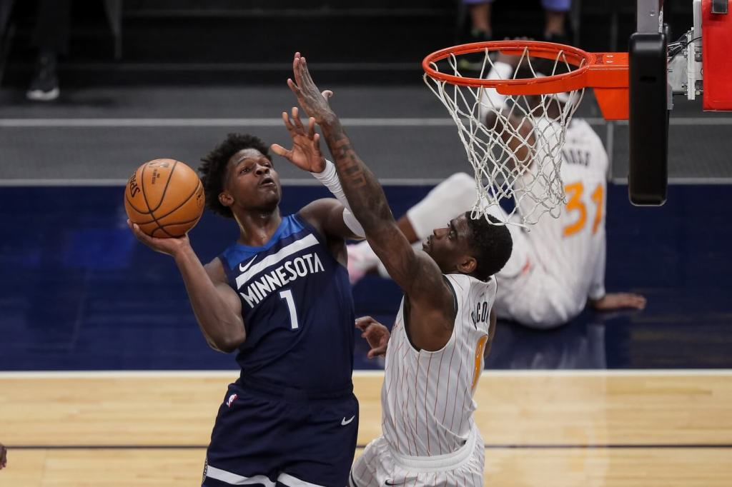 Minnesota Timberwolves guard Anthony Edwards (1) shoots in the second quarter against the Orlando Magic forward Dwayne Bacon (8) at Target Center.