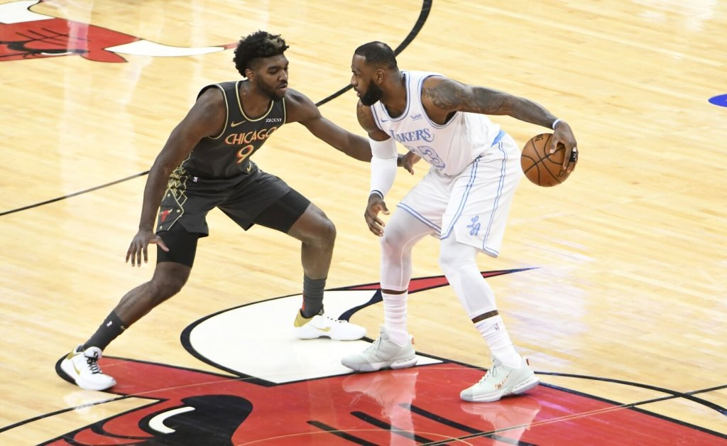 Chicago Bulls forward Patrick Williams (9) defends Los Angeles Lakers forward LeBron James (23) during the first half at United Center.