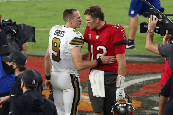 Two of the greatest quarterbacks in NFL history Drew Brees (9) of the Saints and Tom Brady (12) of the Buccaneers share a few words of encouragement after the regular season game between the New Orleans Saints and the Tampa Bay Buccaneers on November 08, 2020 at Raymond James Stadium in Tampa, Florida.