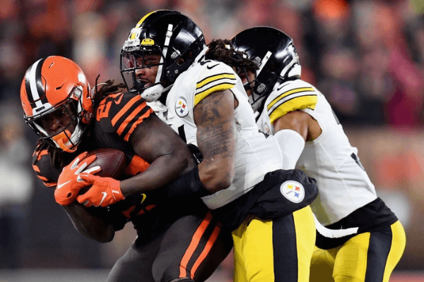 Running back Kareem Hunt #27 of the Cleveland Browns is tackled by the defense of the Pittsburgh Steelers during the game at FirstEnergy Stadium on November 14, 2019 in Cleveland, Ohio.