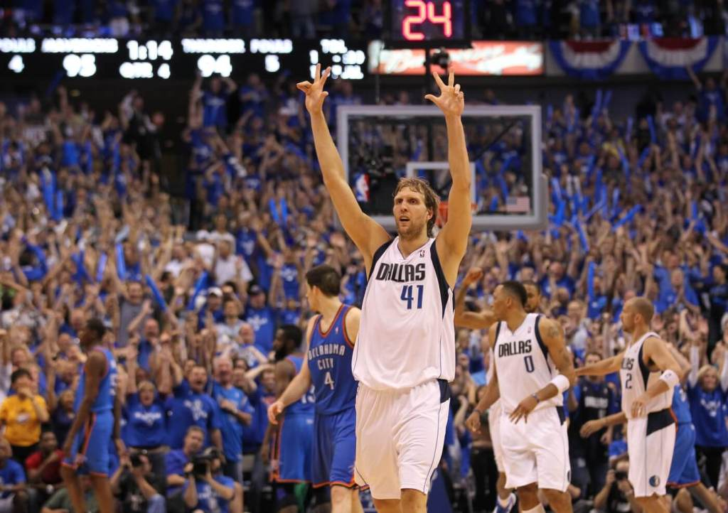 May 25, 2011; Dallas, TX, USA; Dallas Mavericks forward Dirk Nowitzki (41) celebrates after hitting a three point basket in the fourth quarter of game five against the Oklahoma City Thunder for the Western Conference Finals of the 2011 NBA playoffs at American Airlines Center. The Mavs beat the Thunder 100-96. Mandatory Credit: Matthew Emmons-USA TODAY Sports