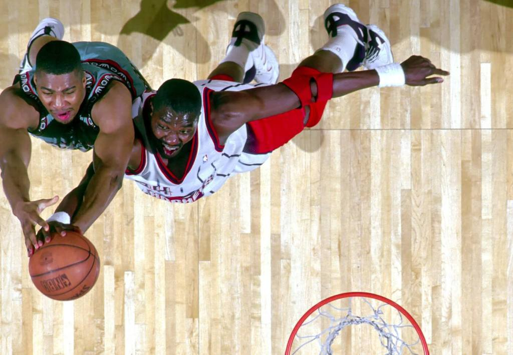 Unknown Date; Houston, TX, USA; FILE PHOTO; Houston Rockets center #34 HAKEEM OLAJUWON in action against the Vancouver Grizzlies at the Summit during the 1996-97 season. Mandatory Credit: Photo By USA TODAY Sports (c) Copyright USA TODAY Sports