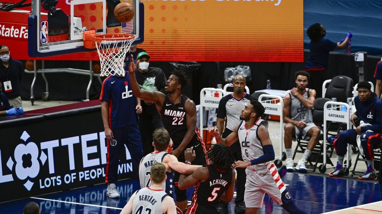 Jan 9, 2021; Washington, District of Columbia, USA; Miami Heat forward Jimmy Butler (22) shoots a layup during the third quarter as Washington Wizards center Moritz Wagner (21) looks on at Capital One Arena. Mandatory Credit: Tommy Gilligan-USA TODAY Sports