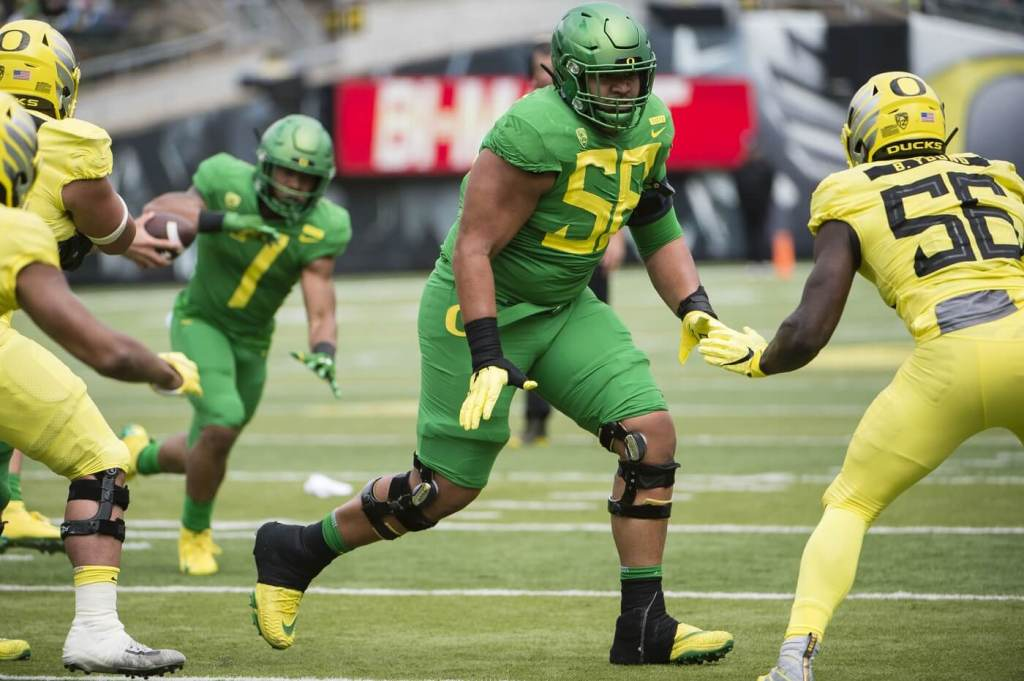 Oregon Ducks offensive lineman Penei Sewell (58) blocks a defender during the Oregon spring game at Autzen Stadium. Mighty Oregon beat Fighting Ducks 20-13.
