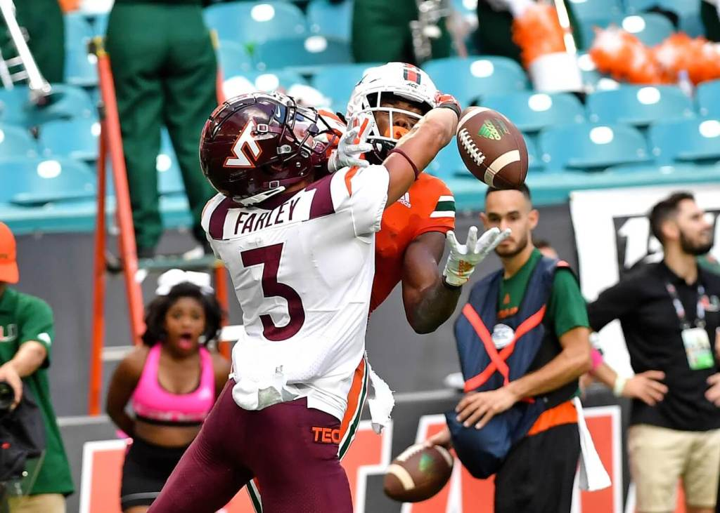 Miami Hurricanes wide receiver K.J. Osborn (2) is unable to make a catch as Virginia Tech Hokies defensive back Caleb Farley (3) defends the play during the second half at Hard Rock Stadium