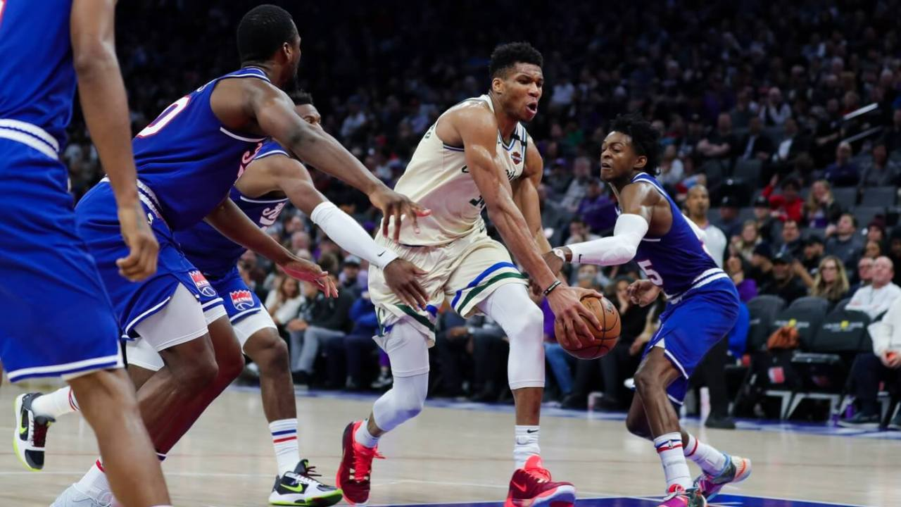 Jan 10, 2020; Sacramento, California, USA; Milwaukee Bucks forward Giannis Antetokounmpo (34) drives to the basket against Sacramento Kings guard De'Aaron Fox (5) during the fourth quarter at Golden 1 Center.