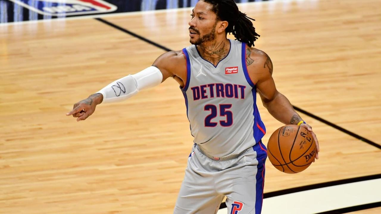 Detroit Pistons guard Derrick Rose (25) controls the ball against the Miami Heat during the first half at American Airlines Arena.