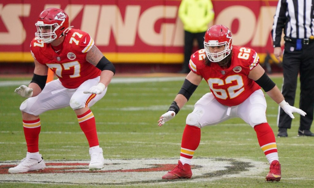 Kansas City Chiefs offensive guard Andrew Wylie (77) and center Austin Reiter (62) prepare to block during the AFC Divisional Round playoff game against the Cleveland Browns at Arrowhead Stadium.