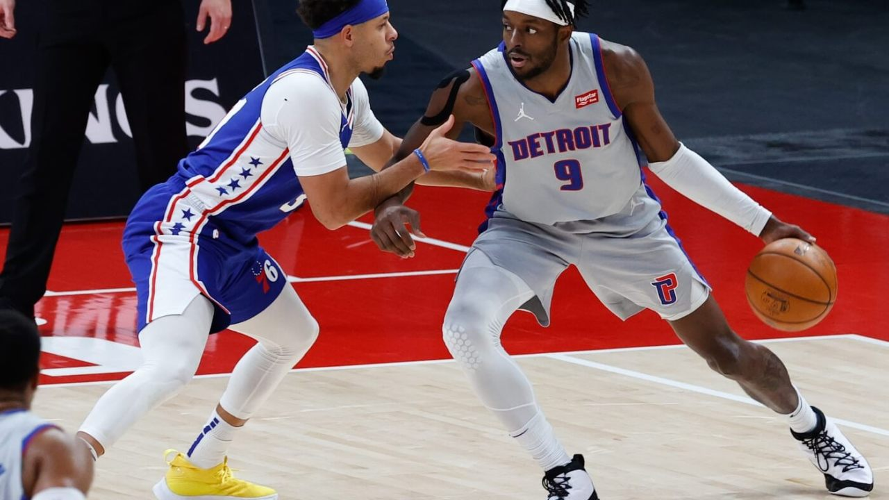 Jan 25, 2021; Detroit, Michigan, USA; Detroit Pistons forward Jerami Grant (9) is defended by Philadelphia 76ers guard Seth Curry (31) in the second half at Little Caesars Arena.