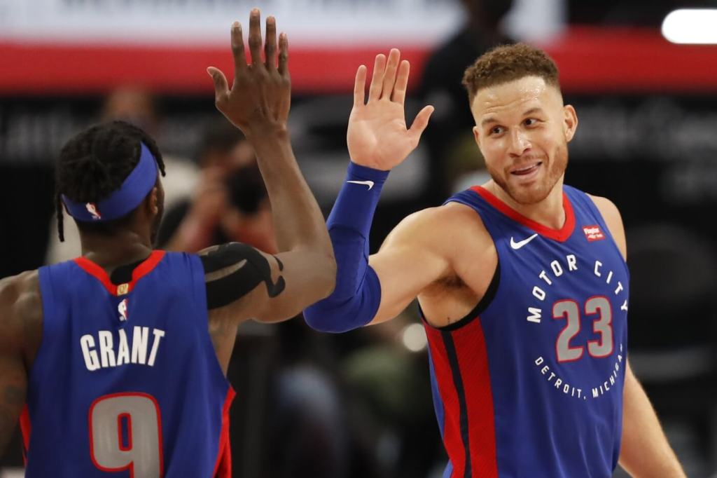 an 28, 2021; Detroit, Michigan, USA; Detroit Pistons forward Blake Griffin (23) gives a high five to forward Jerami Grant (9) during the fourth quarter against the Los Angeles Lakers at Little Caesars Arena.