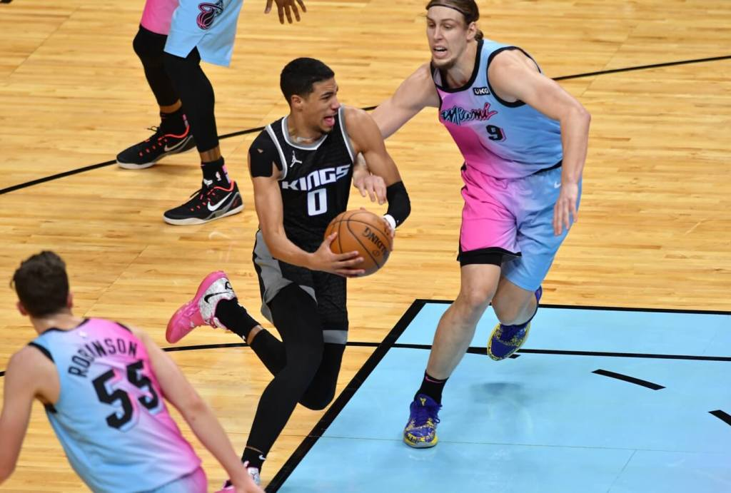 Sacramento Kings guard Tyrese Haliburton (0) drives to the basket as Miami Heat forward Kelly Olynyk (9) defends on the play in the first quarter at American Airlines Arena.