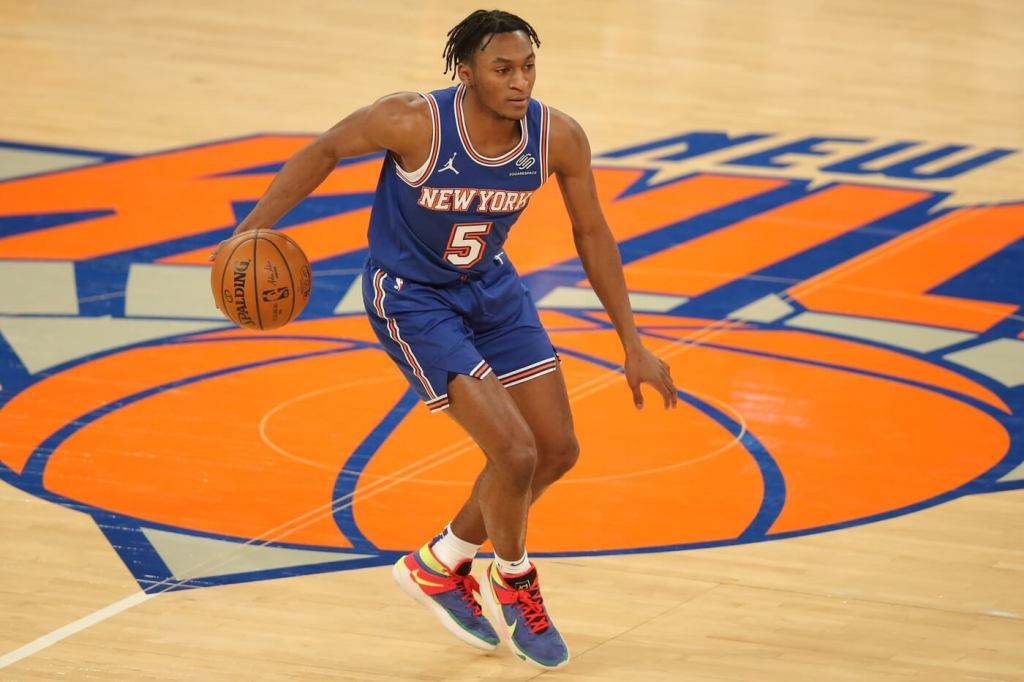 New York Knicks shooting guard Immanuel Quickley (5) brings the ball up court against the LA Clippers during the third quarter at Madison Square Garden.
